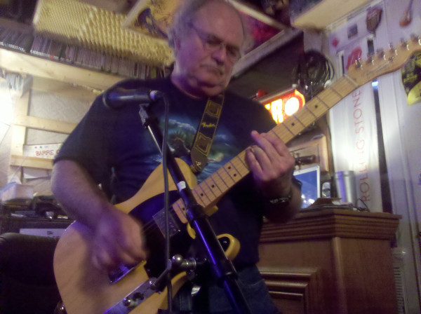 Dad rockin' out on guitar.